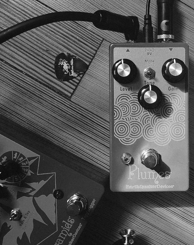 EarthQuaker Devices Plumes pedal, plugged in on the floor