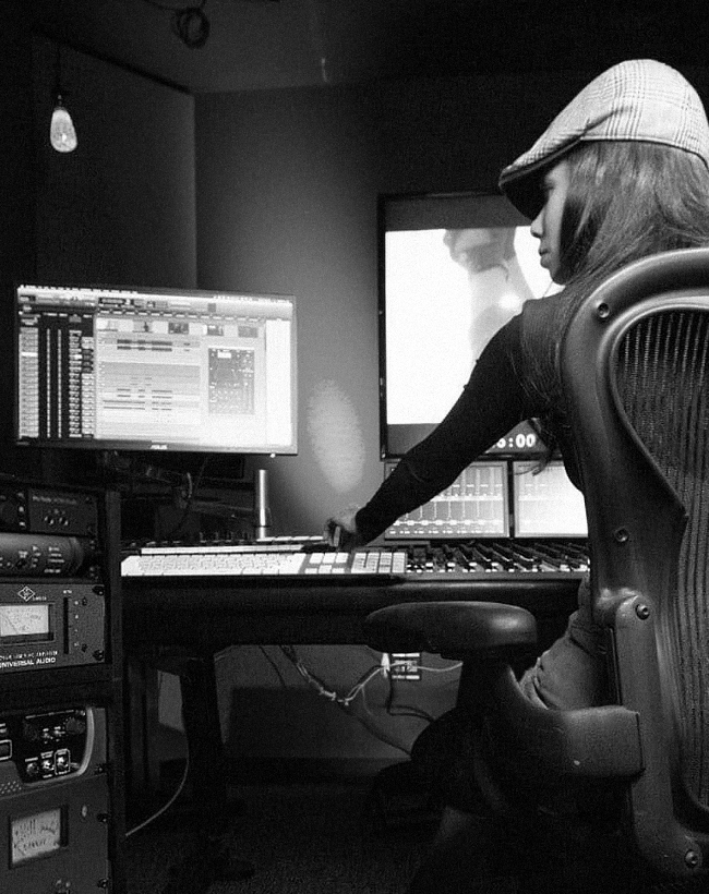 Woman in recording studio using ProTools