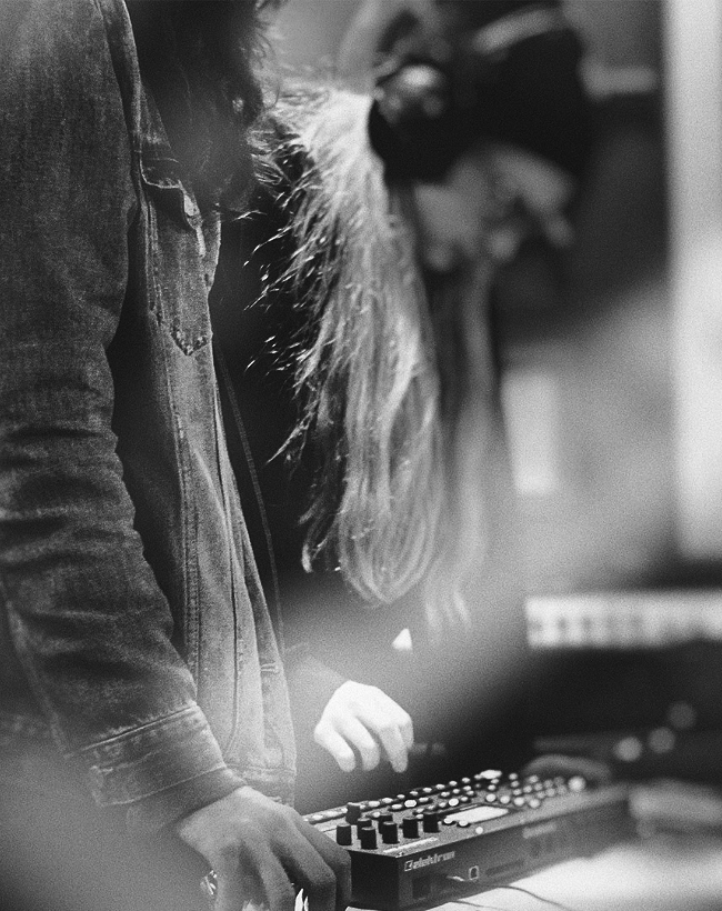 Woman using Elektron Octatrack.