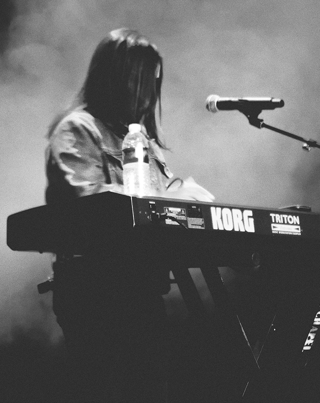 Musician on stage playing Kork keyboard.